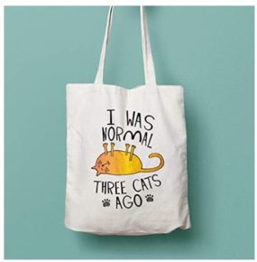 Tote shopping, re-usable cat bag with the words 'I was normal three cats ago'.